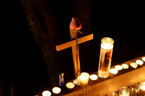 ROSE SET ON CROSS AT MEMORIAL TO SANDY HOOK ELEMENTARY SHOOTING VICTIMS