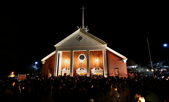 CROWD SURROUNDS CATHOLIC CHURCH IN CONNECTICUT COMMUNITY ROCKED BY SCHOOL SHOOTING