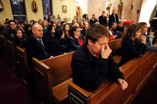 MOURNERS GATHER AT NEWTOWN'S CATHOLIC CHURCH FOR VIGIL SERVICE FOLLOWING SCHOOL TRAGEDY